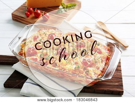 Cooking school concept. Pasta Al Forno in baking dish on wooden board