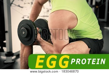 Egg protein concept. Muscular man training in gym
