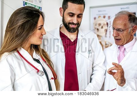 doctors talking about therapy and exams of a patient to decide how to proceed