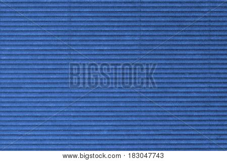 The blue perforated cardboard texture as background