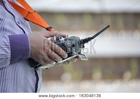 Remote control for sports model in the hands of men. Hobby