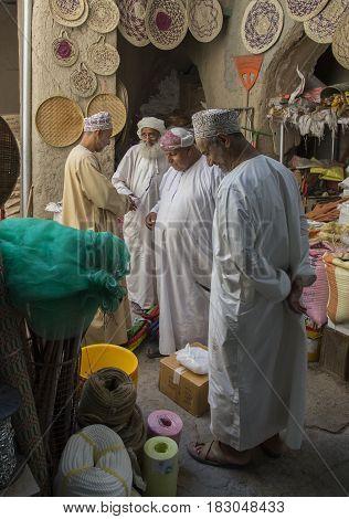 Omani Men Shopping At A Market