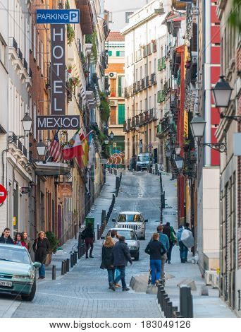 Madrid, Spain - November 9th, 2013:    Tourists leaving & arriving at local hotels.  Despite downturning economies, people beat the norm taking off-season vacations in Europe.