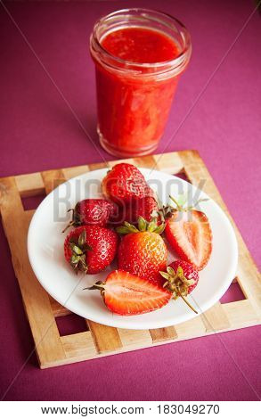 strawberry season: fresh berries on plate with juice