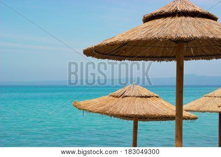 Summer - straw sunshades on the beach
