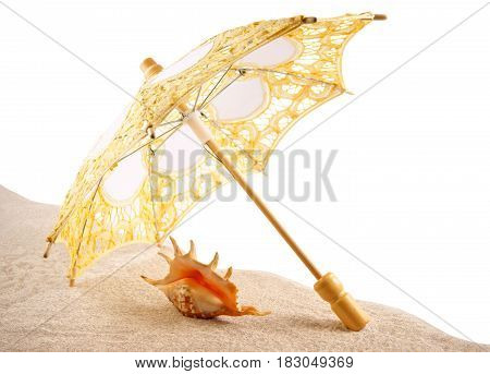Shell under an umbrella on the sand white background