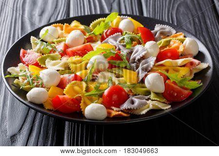 Italian Food: Farfalle Pasta With Vegetables And Mozzarella Close-up. Horizontal