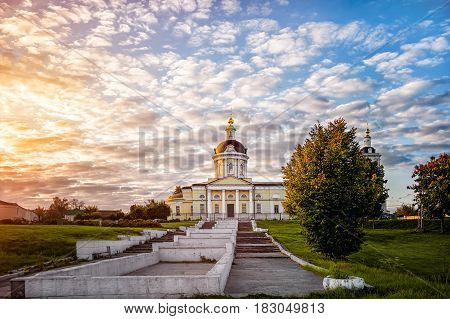 Kolomna Church of the Archangel Michael with a bell tower at dawn with beautiful clouds and Golden light.