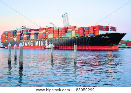 March 9, 2017 in San Pedro, CA:  Yang Ming Marine Freighter Ship transporting commerce in containers to International locations taken at San Pedro Harbor where people can watch Freighter and Cruise Ships depart the harbor to the Pacific Ocean