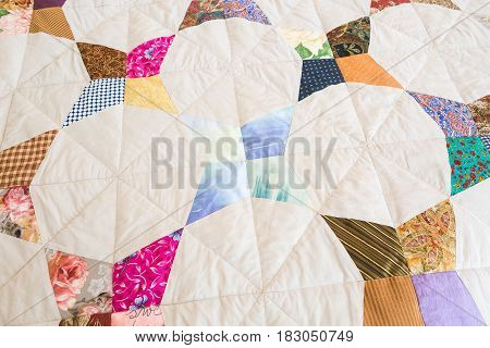 Part of color patchwork quilt as background. Handmade, art, hobby concept. Colorful Scrappy blanket. top view.