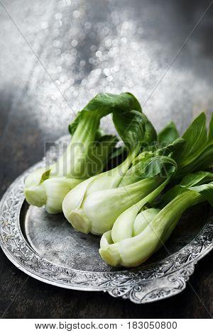 Pak Choi Oriental organic vegetable in rustic style