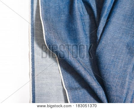 Denim blue jeans texture. Legs jeans textile. Folds fabric on white background
