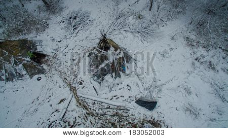 Aerial view near of Kinderlinskaya cave and village Tash-Asty on Zilim river. Life in the tipi at winter