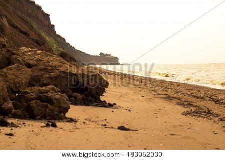 Wild beach sea waves coastline sunny evening