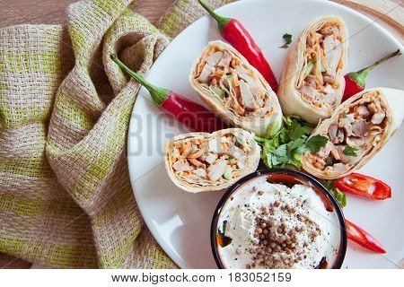 hot spicy armenian shawarma on plate with napkin
