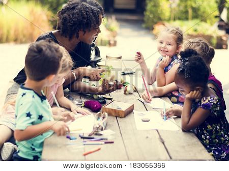 Group of children drawing imagination outdoors