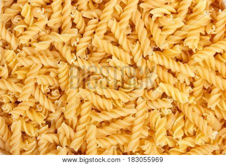 Close up view at the fusili pasta Macaroni background or texture