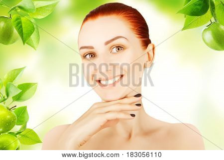 beautiful red haired woman with green apples background
