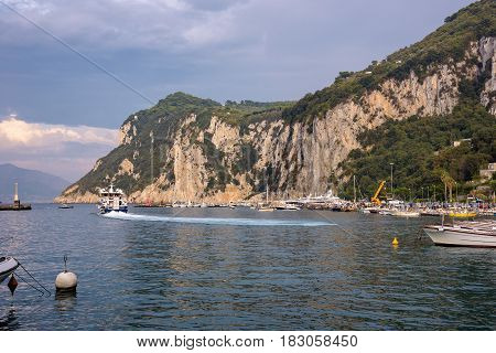 Tourist ship leaving Capri Island at sunset Campania Italy