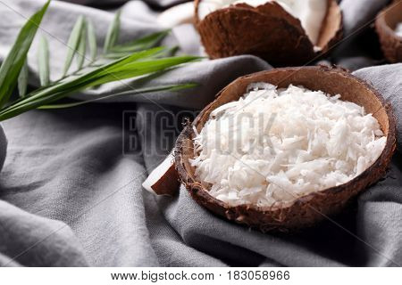 Beautiful composition with coconut shavings on table
