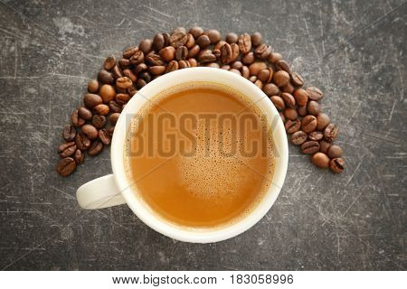 Cup of tasty butter coffee on grey background