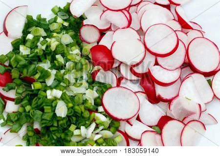 Spring salad with radishes and green onions. Fresh traditional dish of Slavic cuisine.