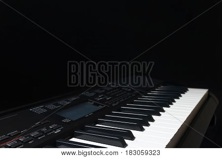 Modern electronic synth on a black background