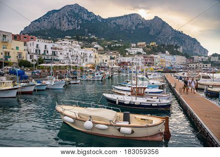 Capri Italy - August 31 2016: Boats moored at Marina Grande on famous italian island of Capri.