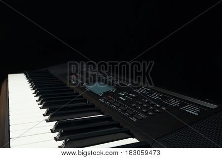 Keyboard of the synth on a black background