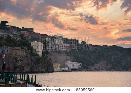 View of cliff coast in Sorrento town in southern Italy at sunset