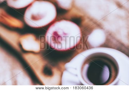Cupcake and coffee on old dark rustic wooden table, blurred background
