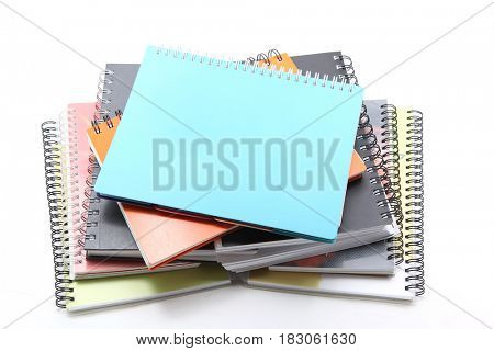 studio shot of ring binder book stack isolated on white
