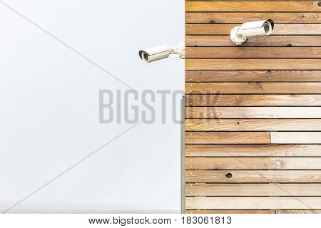 Security Camera CCTV on wooden panel wall