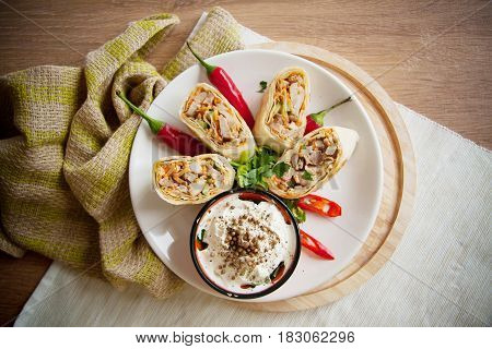 armenian shawarma with chilli peppers and sour cream on plate
