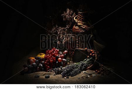 Still life with grapes lavender and a wicker bottle