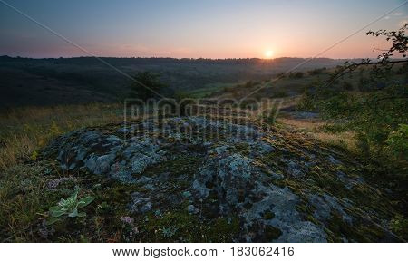 Sunrise over the valley of the granite mountain ridge