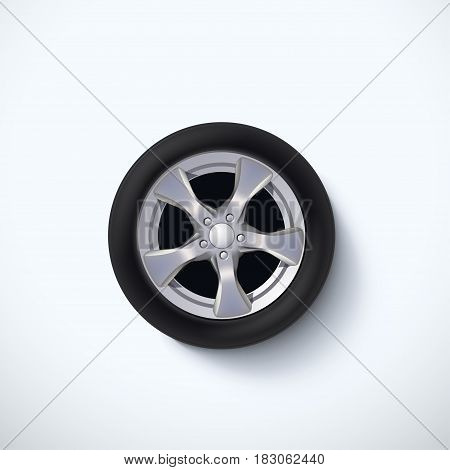 illustration of lying realistic car wheel on white background with soft shadow