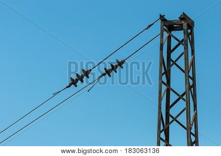 Railroad tracks with railway electrification system. Overhead line wire over rail track. Power lines. Vintage image. Railway.