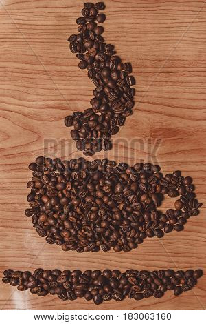 the coffee beans on old table for background
