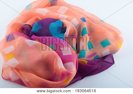 Fragment of semitransparent chiffon fabric with pattern on white background