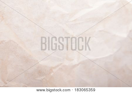 Crumpled baking paper pastel or tracing paper items background for objects