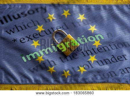 Closed padlock on the flag of European Union and dictionary definition of Immigration