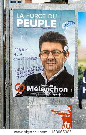 STRASBOURG FRANCE - APR 26 2017: Official campaign posters of Jean-Luc Melenchon political party leader of La France insoumise vandalized on the first round of 2017 French presidential election