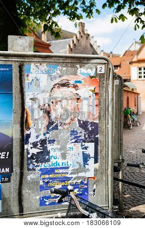 STRASBOURG FRANCE - APR 23 2017: Official campaign posters of Marine Le Pen political party leader of Front national (FN) vandalized on the first round of 2017 French presidential election