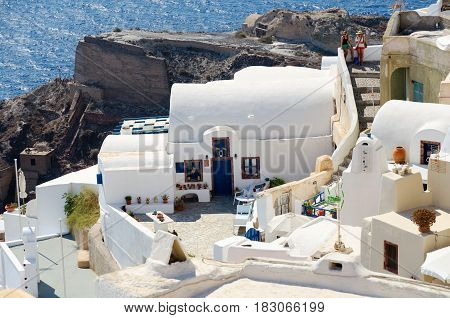 Traditional white architecture on cliffs of Santorini island, Greece