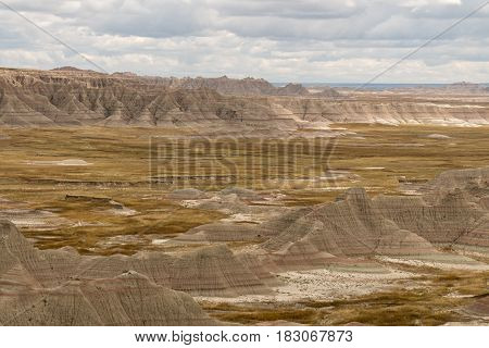 The Badlands in South Dakota on a cloudy day.