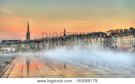 Famous water mirror fountain in front of Place de la Bourse in Bordeaux - France, Aquitaine