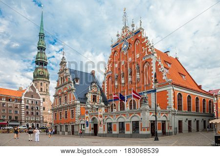Riga Latvia - 25-August-2015: Town Hall Square - house of the Blackheads and Saint Peters Church in old town of Riga Latvia.