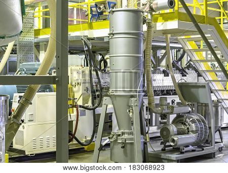 Factory from the inside.  Industrial building interior. Plant for the production of plastic film.