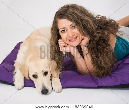 Cute golden retriever dog with owner woman look at camera isolated over a white background. Dogs and woman friendship